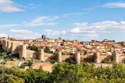 Leinwanddruck Bild Panoramic view of the historic city of Avila from the Mirador of Cuatro Postes, Spain, with its famous medieval town walls. UNESCO World Heritage. Called the Town of Stones and Saints