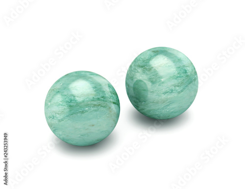 Two polished stone spheres, meditation balls isolated on white. Clipping path included