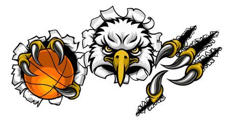 An eagle bird basketball sports mascot cartoon character ripping through the background holding a ball © Christos Georghiou