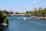 white boat crosses the Seine in Paris