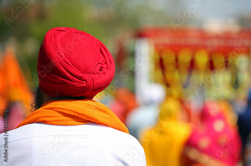 the red turban worn by a bearded man of Sikh religion