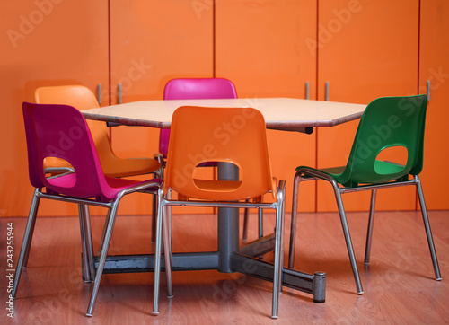 inside a school classroom of a kindergarten with small chairs