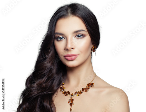 Jewelry woman with gold amber necklace and earrings isolated on white background