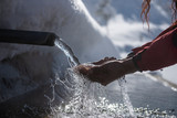 drinking from pure and healthy mountain waters