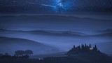 Stunning milky way over foggy farm in Tuscany, Italy - 243262924