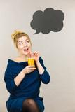 Happy woman holding fresh orange juice - 243264301