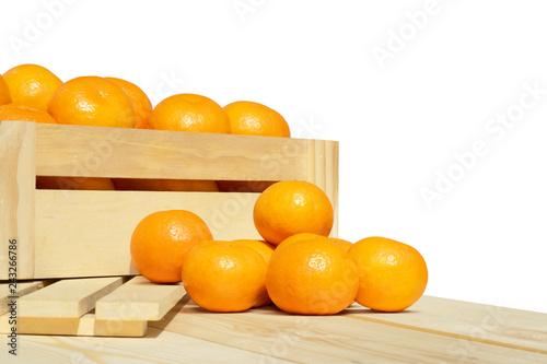 fresh orange fruits on wooden table top