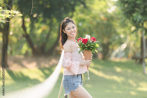 young woman asian girl with roses red smiling hoppy in valentines day