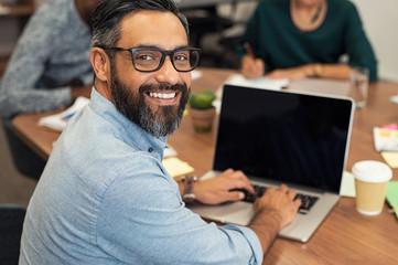 Latin mature businessman working on laptop © Rido