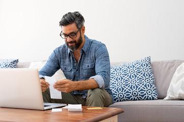 Man reading bills © Rido