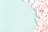 Fototapety Flowers composition. Rose flower petals on pastel blue background. Valentine's Day, Mother's Day concept. Flat lay, top view, copy space
