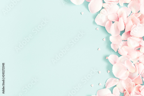 Flowers composition. Rose flower petals on pastel blue background. Valentine's Day, Mother's Day concept. Flat lay, top view, copy space - 243272548