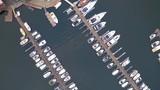 vertical view motorboats moor to wooden piers in fjord - 243274774