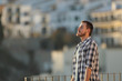 Leinwanddruck Bild - Relaxed man in a town breathing fresh air