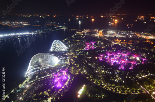 Aerial night view of Singapore and ships in the distance