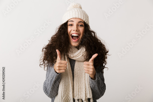 Leinwandbild Motiv Happy young woman wearing winter clothes