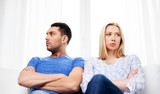 people, relationship difficulties, conflict and family concept - unhappy couple having argument at home - 243285556