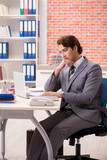 Young businessman working in the office - 243285705