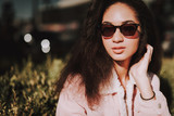 Close up of young beautiful lady in sunglasses - 243289741