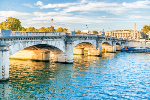 Wall mural Old stone bridge across Seine river in Paris