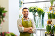 sale, small business and floristry concept - happy smiling florist man or seller at flower shop - 243293991