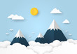 Beautiful mountain landscape with clouds and sun on blue background, paper art style