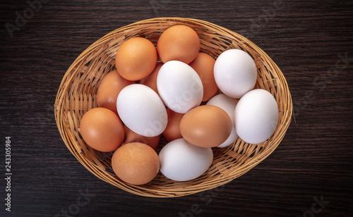 chicken eggs in a wicker bowl
