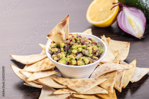 guacamole with corn chips closeup