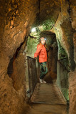 Young tourist woman explore ancient Kaymakli underground cave city - 243311113