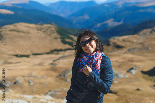 woman in sunglasses and scarf in transalpina