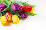 Fototapeta Tulipany - Bouquet of fresh multicolor tulips close-up. © flycatdesign