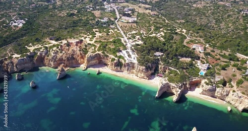 Aerial view of beautiful landscape and rocky beaches of Algarve coast in Portugal summertime.