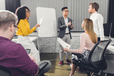 professional young multiethnic business people discussing during meeting in office - 243325580