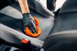 Leinwandbild Motiv Chemical cleaning of car seats with spoonge