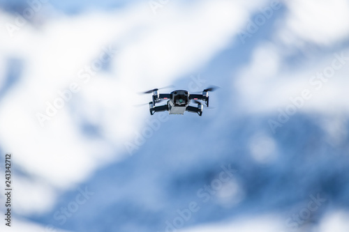 drone flies in the mountains