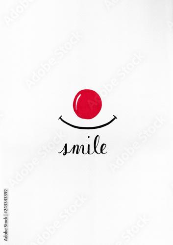 canvas print picture Eine gezeichnete rote Nase und 1 hand geschriebenes Wort in englisch mit der Bedeutung: lächeln machen gute Laune.