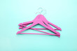 Pink hangers on blue background