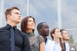 business team standing in a row at office and looking upwards - Successful business team.