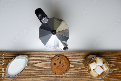 Glass cup of coffee, coffee maker and dessert. Top view.