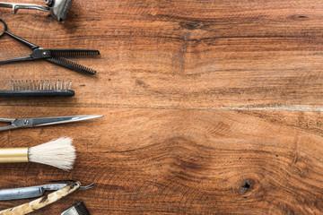 Old vintage barbershop tools on wooden table - barbershop background with copy-space