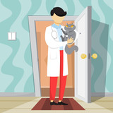 Veterinarian in uniform holding a pet cat.