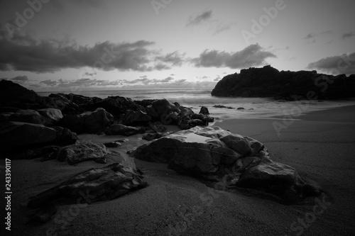 Empty rocky beach at dusk