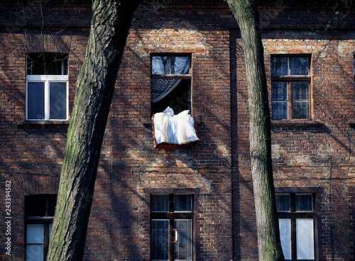 Lodz, Poland - March, 2012: the workers' houses, Ksiezy Mlyn in Lodz - 243394582