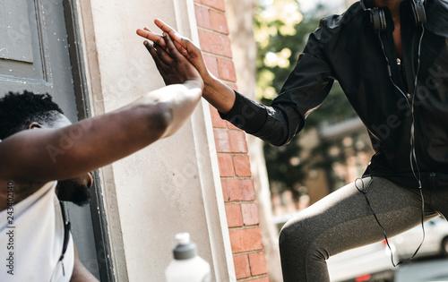 Leinwanddruck Bild Fitness partners giving each other a high five