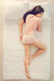 Pretty girl sleeping on stomach - 243406911