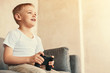 Quadro Handsome little boy holding video game controller