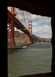 Golden Gate bridge from the window of Fort Point on a partly cloudy day