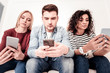 Smart young people using their smartphones
