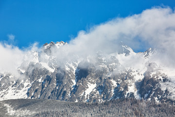 Mountains in snow covered with larch trees in Tatranska Lomnica, popular travel destination and ski resort in Slovakia