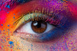 Leinwanddruck Bild - Close up view of female eye with bright multicolored fashion makeup. Holi indian color festival inspired. Studio macro shot